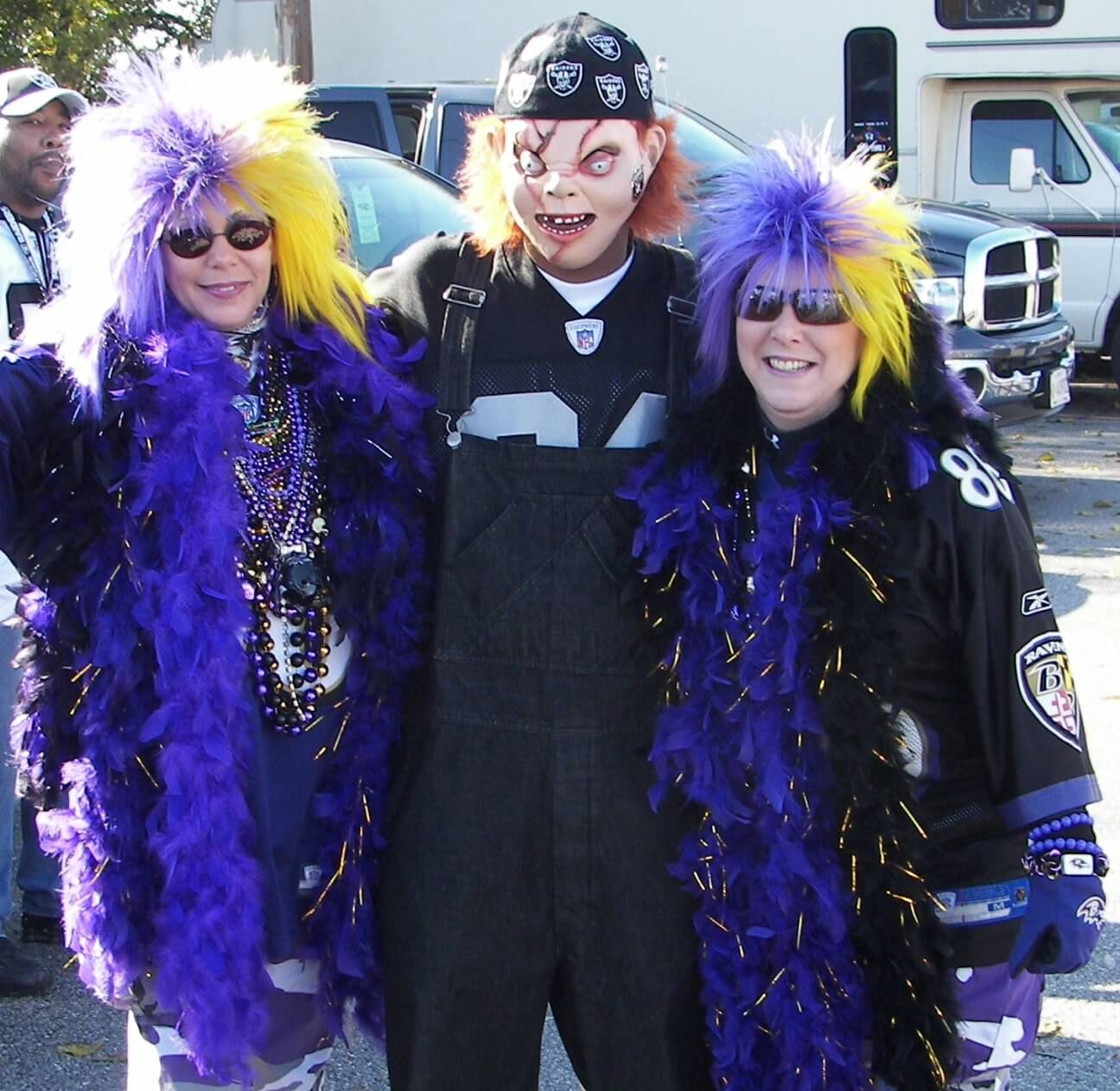 Oakland Raiders fans in costume on game day