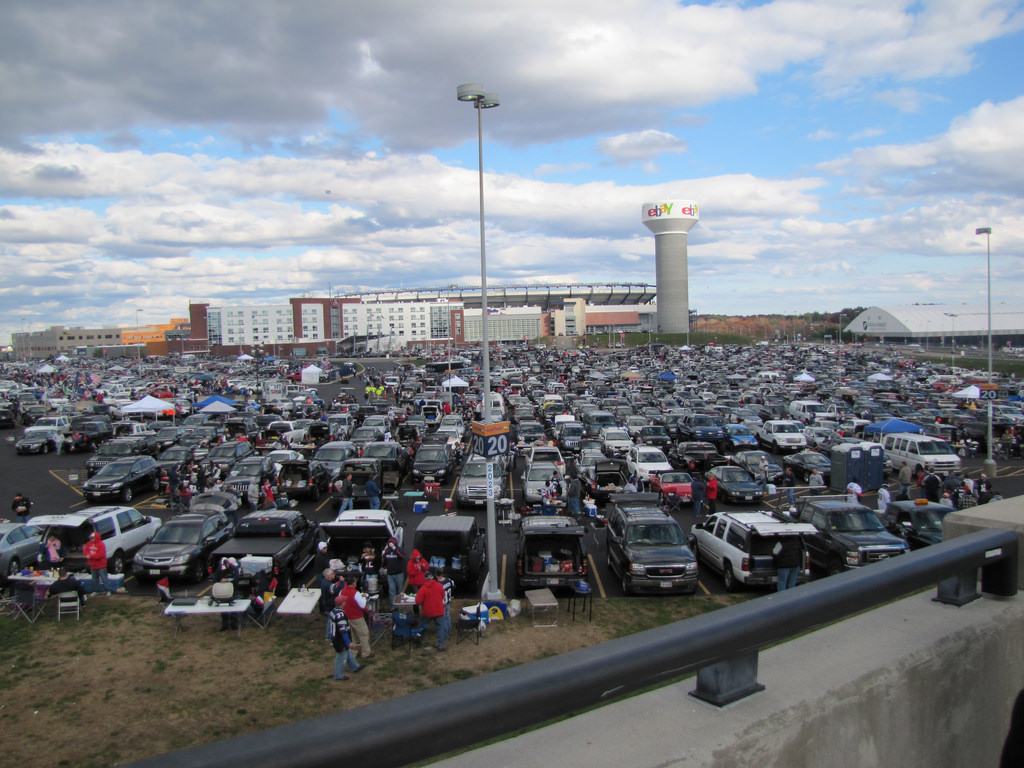 New England Patriots fans tailgating at parking lot outside Gillette Stadium