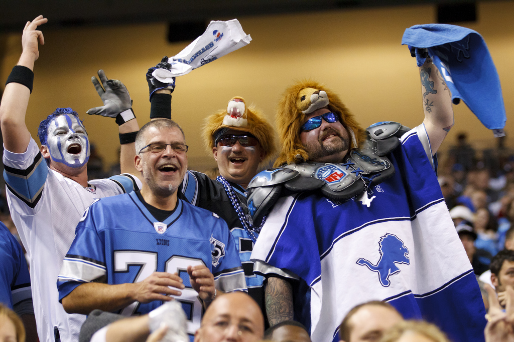 fans cheering at Detroit Lions game