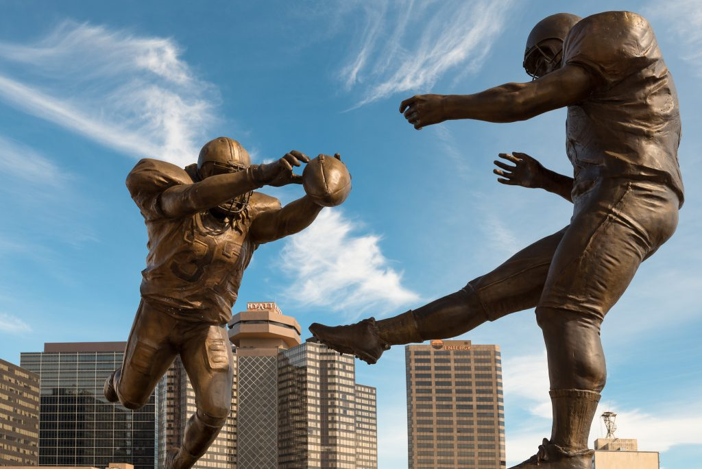 statues of football players at Mercedes Benz Superdome home of New Orleans Saints