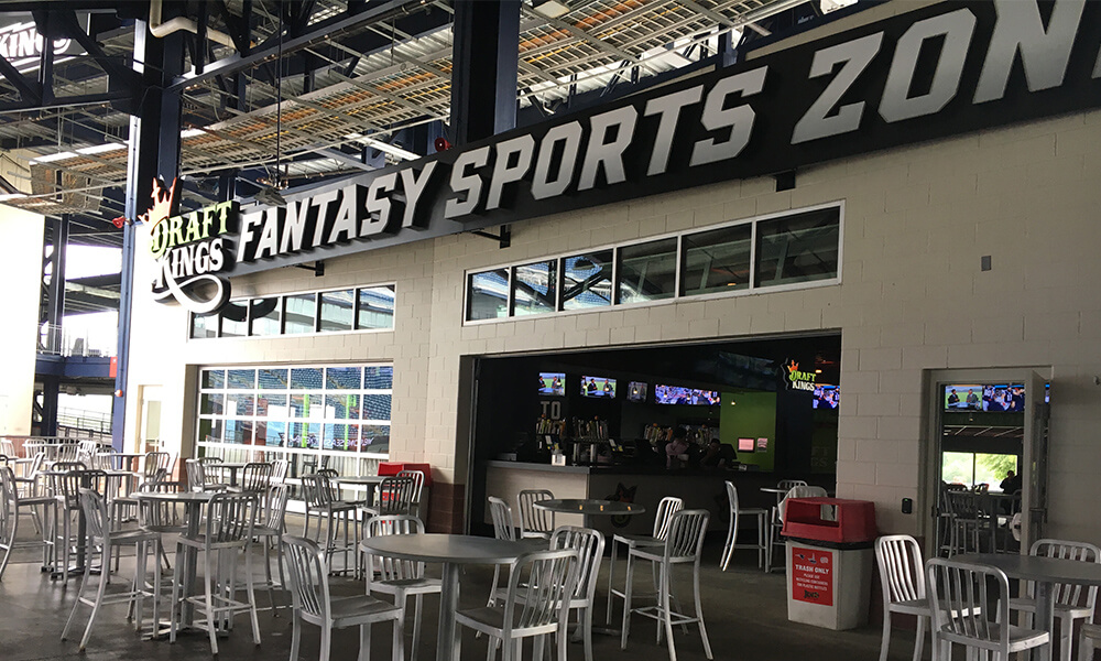 fans eat and drink on football NFL game day at DraftKings Fantasy Sports Zone Gillette Stadium