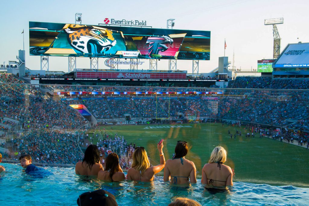 fans at the swimming pool in TIAA Bank Field while watching a Jacksonville Jaguars game