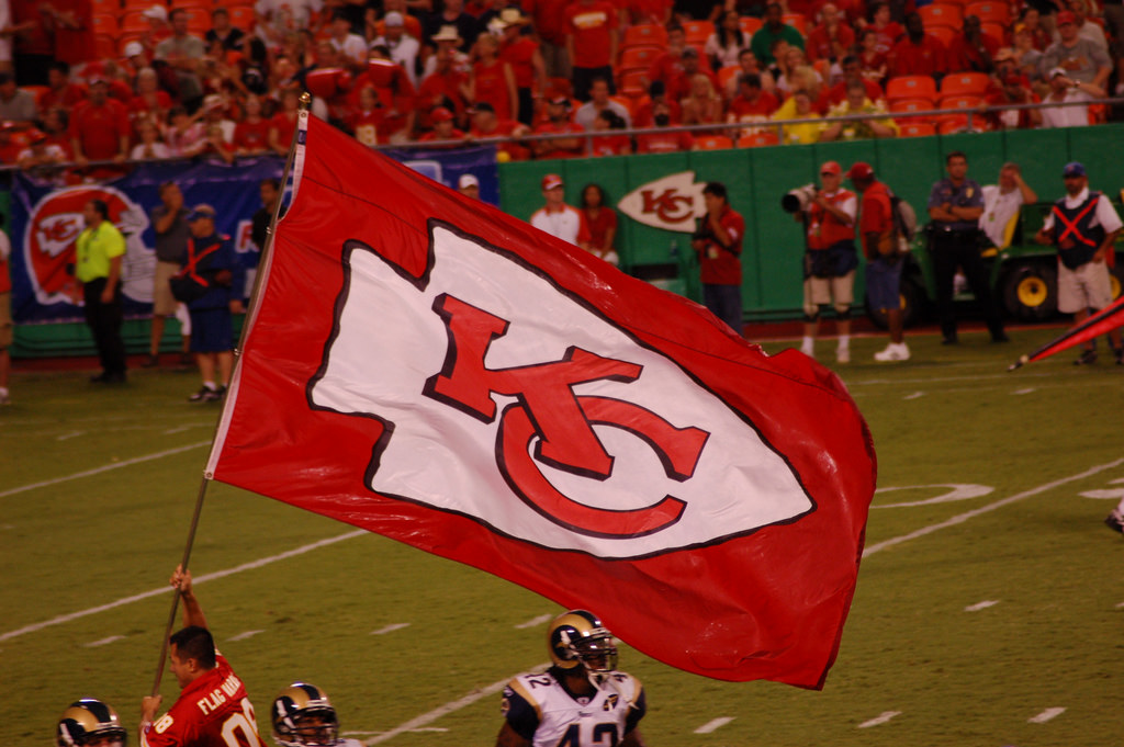 Kansas City Chiefs fans flag and players