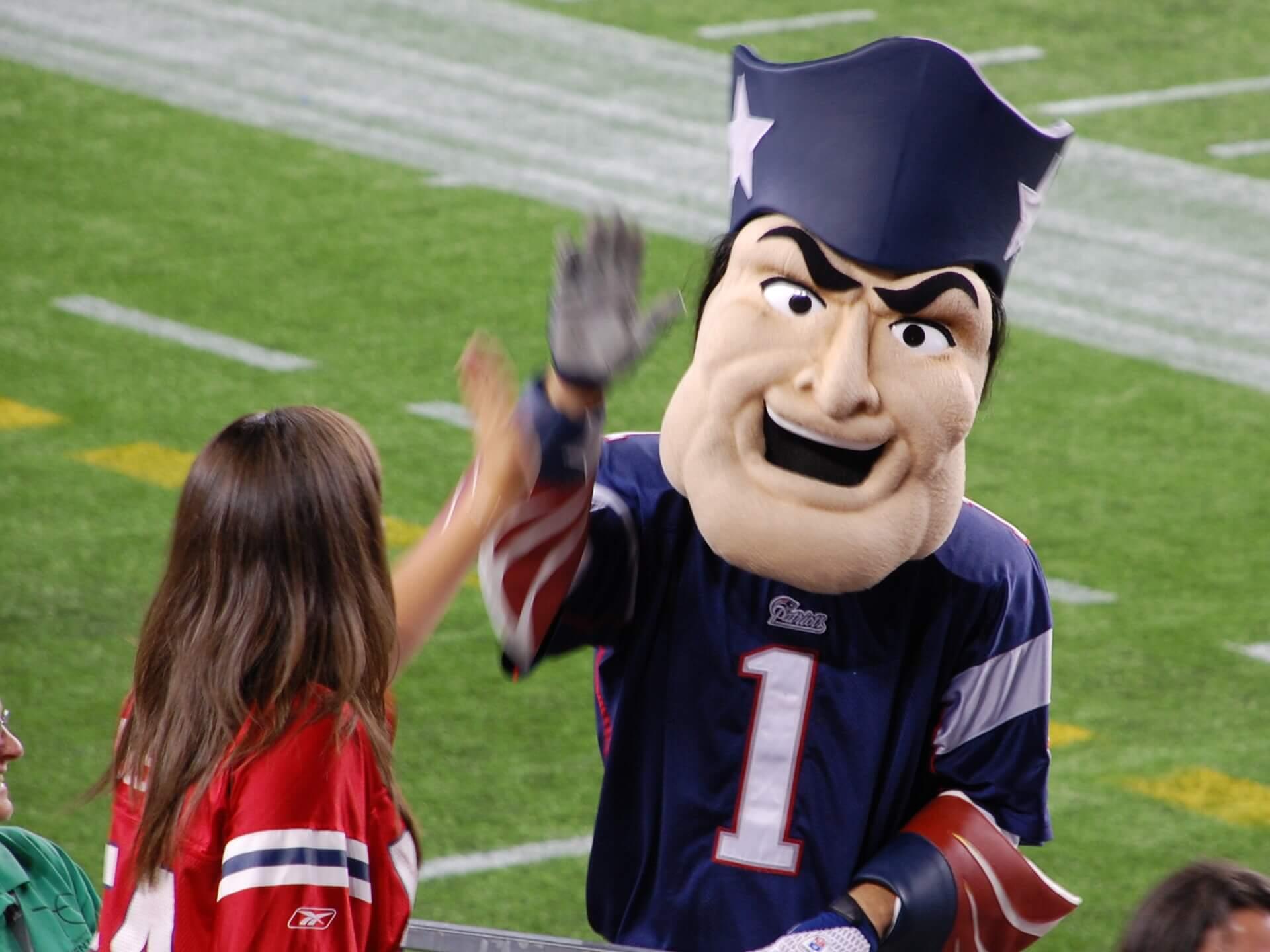 New England Patriots mascot Pat Patriot high fives a Pats fan