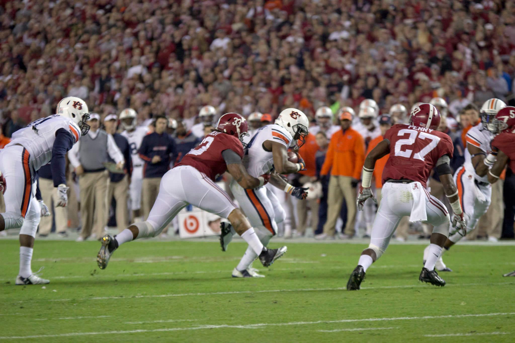 Alabama Crimson Tide vs Auburn Tigers NCAAF football rivalry